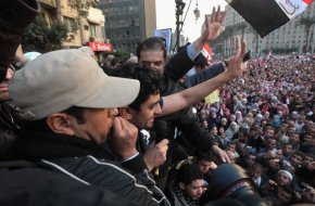Wael Ghonim greets thousands of protesters in Tahrir Square on Feb 8, 2011