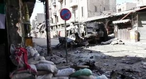 Bombed out vehicles Aleppo during the Syrian civil war, October 2012/ Wiki image