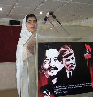 The picture in which she is seen with a poster of Lenin and Trotsky should indicate her proximity to some of the most ideologically groomed bunch of men and women in Swat