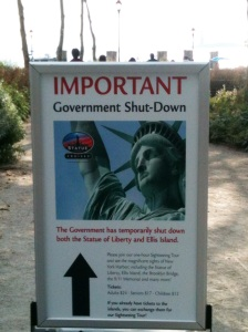 US federal government shutdown notice posted on October 1, 2013 by the ferry operator at the entrance of the Statue of Liberty ferry. The outline of the Liberty Island is vaguely visible in the background at the upper right corner of the picture. (photo: wiki)