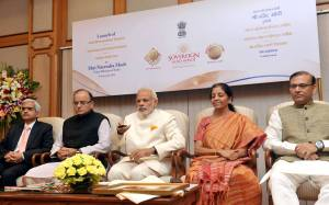 The Prime Minister, Shri Narendra Modi launches the Gold schemes, in New Delhi on November 05, 2015. The Union Minister for Finance, Corporate Affairs and Information & Broadcasting, Shri Arun Jaitley, the Minister of State for Finance, Shri Jayant Sinha, the Minister of State for Commerce & Industry (Independent Charge), Smt. Nirmala Sitharaman and the Secretary, Department of Economic Affairs, Ministry of Finance, Shri Shaktikanta Das are also seen. (photo courtesy: FM Arun Jaitley's Facebook Page )