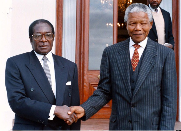 Nelson Mandela pictured with Zimbabwean president, Robert Mugabe